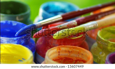 Color bottles and brushes for artistic paintings. - stock photo