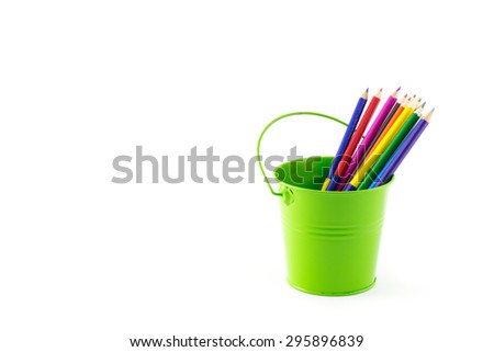 Color bucket with multicolor pencils, isolated on white background - stock photo