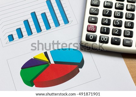 Color business graph on paper and calculator background