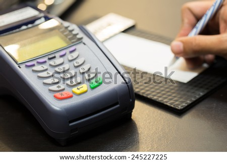 Color Buttons on Credit Card Machine With Signing Transaction In Background : Selective Focus - stock photo
