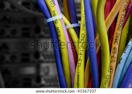 Color cables in the back of the server rack with black and white background out of focus - stock photo