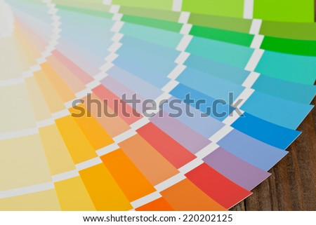Color chart guide on wooden surface - stock photo