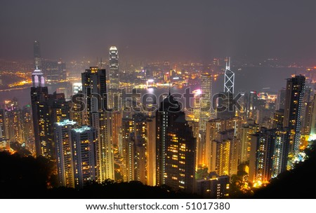 Color city night with building skyline and skyscraper in Hong Kong. - stock photo