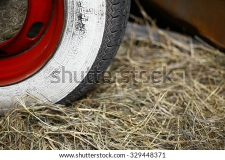 color closeup shot of a whitewall vintage car tire