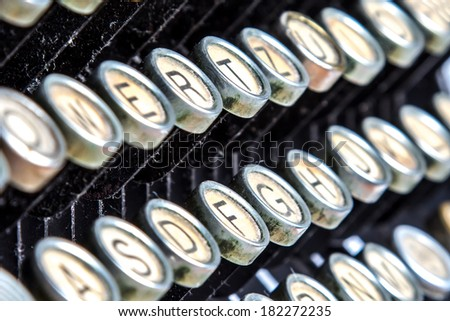 Color close-up view of an old typewriter keys - stock photo