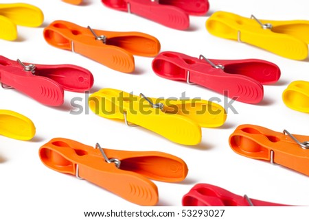 color clothes pins on white background