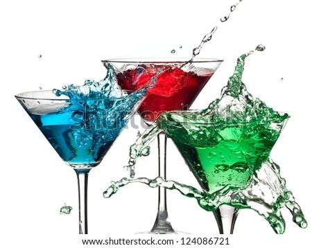Color cocktails in martini glasses splash - stock photo