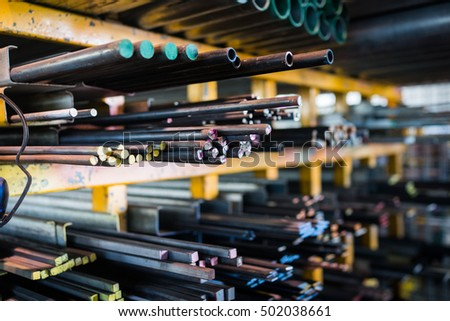 Color-coded Steel beams and tubes in a factory warehouse.
