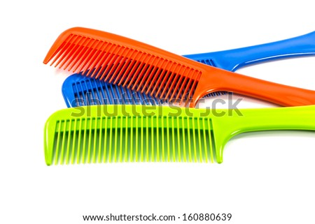 color  comb on a white background. - stock photo