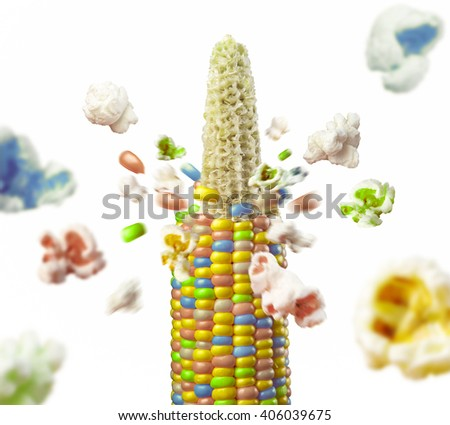 color corncob explodes and produces popcorn healthy vegetarian food. on the white background