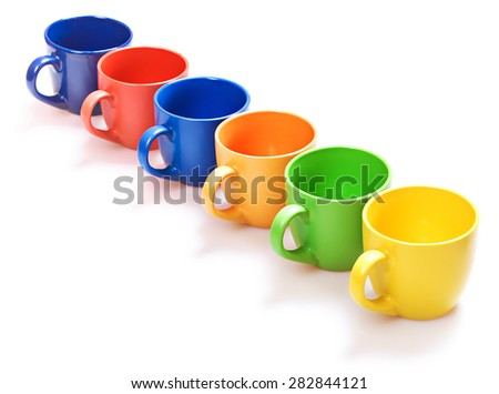 Color cups on white background. - stock photo