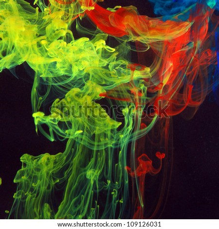 Color dance Description: Blue, red and yellow ink in the water - stock photo
