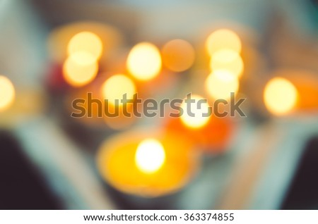 Color de-focus candles light background. Holiday candles close up. Abstract glowing background - stock photo
