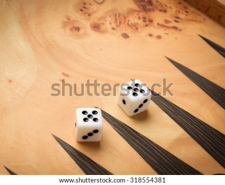 Color detail of a Backgammon game with two dice close up - stock photo