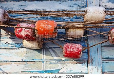 Color detail of an old fishing net on old blue wooden background.Close-up of fishing equipment. - stock photo