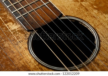 Color detail of an old, vintage guitar - stock photo