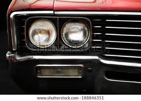 Color detail on the headlight of a vintage car - stock photo