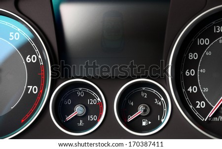 Color detail with the gauges on the dashboard of a car - stock photo