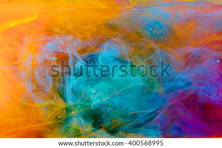 Color drop in water, photographed in motion. Ink swirling. Cloud of silky ink under water isolated on white background. Colorful ink in water, ink drop. - stock photo