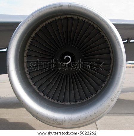 Color DSLR image of a grey jet engine with swirls on an United States Air Force military KC-135 refueling tanker airplane.  Isolated.  Horizontal.