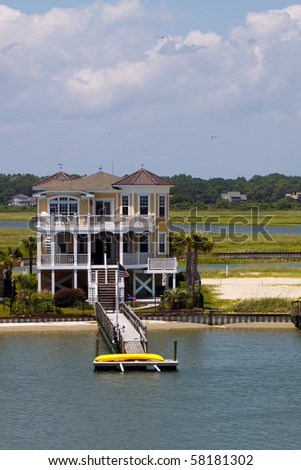 Color DSLR image of a luxury beach vacation house on the inter coastal waterway, Sunset Beach, North Carolina. Vertical with copy space for text