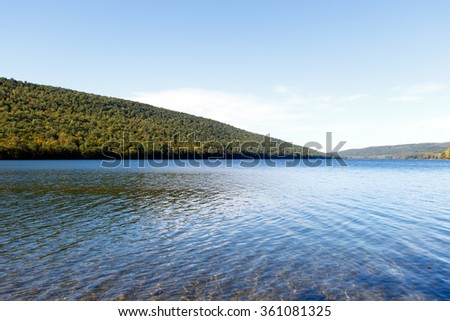 Color DSLR image of Canadice Lake, one of the New York Finger Lakes; horizontal with copy space for text