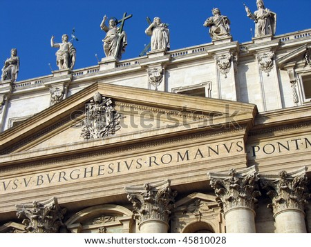 Color DSLR image of statues on top of a St. Peter's Basilica, Rome, Italy, The ancient center of the Catholic faith is popular with tourist and religious pilgrims. Horizontal with blue sky background - stock photo