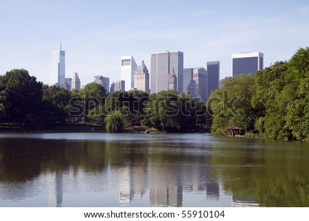 Color DSLR image of the lake in Central Park, New York City with skyscrapers and urban skyline in the background reflecting off the calm water. Horizontal with copy space for text. - stock photo