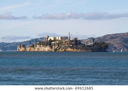 Color DSLR image of The Rock, Alcatraz in San Francisco harbor, in horizontal orientation with copy space for text. Historic jail is a popular California tourist destination. - stock photo