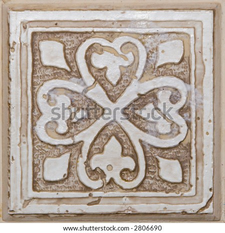 Color DSLR picture of a square, white, off white, beige or tan decorative ceramic tile with flower pattern. Good for design, background and details. - stock photo