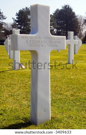Color DSLR picture of a white cross grave marker for unknown soldier at Normandy American Cemetery, France. Dead from WWII are buried in the landmark war memorial.   Vertical with copy space for text - stock photo