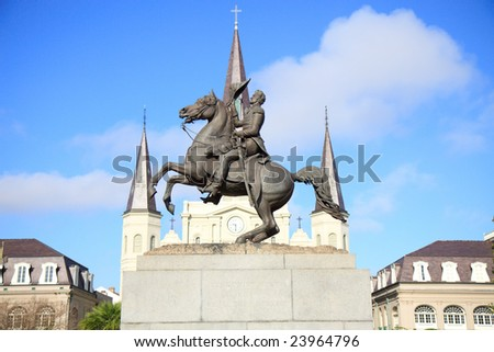 Color DSLR picture of Statue of Andrew Jackson, in Jackson Square, the French Quarter, New Orleans, Louisiana with the steeples of the St. Louis Cathedral in the background. Copy space for text. - stock photo