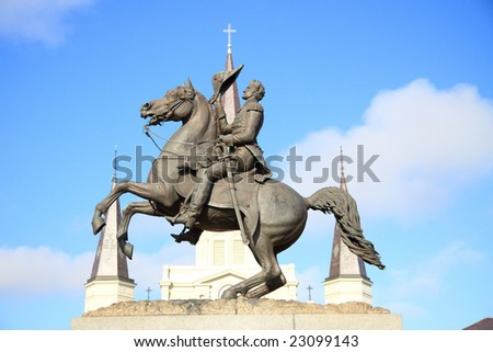 Color DSLR picture of statue of President Andrew Jackson on a horse, in Jackson Square, New Orleans, Louisiana, with the spires of St. Louis Cathedral in the French Quarter background - stock photo