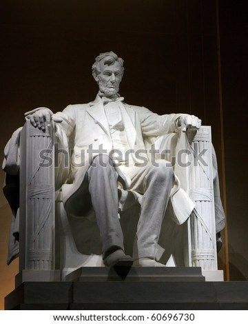 Color DSLR picture of the Statue of Abraham Lincoln at the Lincoln Memorial, at night.  The symbol is a popular tourist destination, though no people are seen.  Vertical with copy space for text. - stock photo