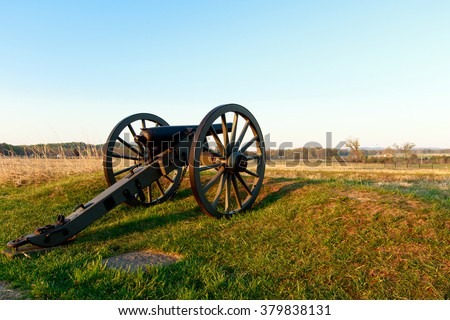 Color DSLR stock image of a civil war cannon in a field at Gettysburg, Pennsylvania battle memorial. Horizontal with copy space for text - stock photo