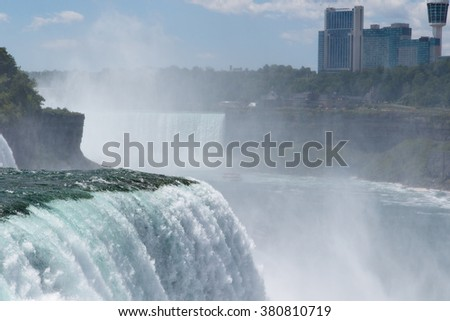Color DSLR stock image of Niagara Falls, showing American Falls and Canadian side; horizontal with copy space for text