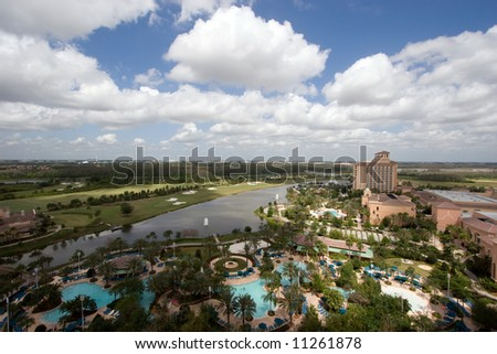 Color DSLR wide angle view of Florida luxury vacation golf resort with hotel, pool, golf course and lake, taken from above. Horizontal with copy space for text. - stock photo
