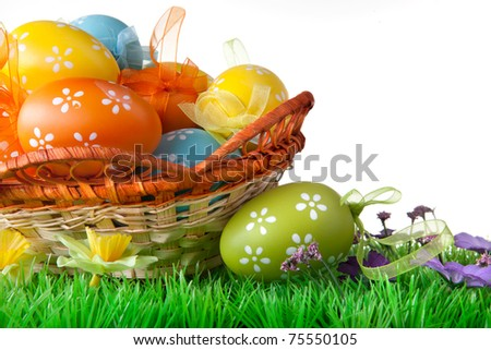 color easter eggs in basket isolated on white - stock photo