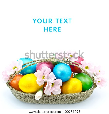 Color Easter eggs in the basket with flowers isolated on a white background - stock photo
