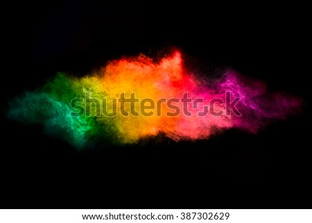 Color explosion. Abstract design of a dust cloud. Colorful rainbow of dust particles isolated on black background - stock photo