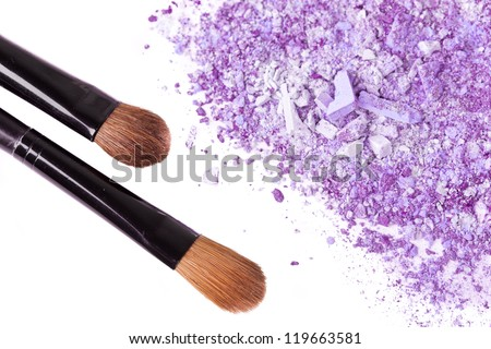 Color eyeshadows with brushes, close up on white