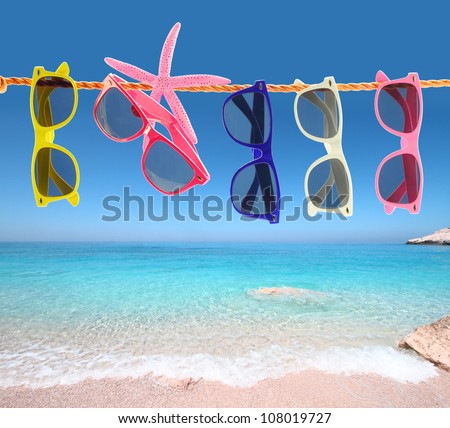Color fashion sunglass. Summer time, beach background