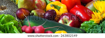 Color fruits and vegetables mixed together - panorama - stock photo