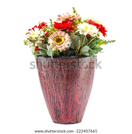 Color full plastic flowers in color full pottery jar - stock photo