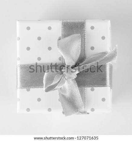 Color gift box with silver ribbon, isolated on white - stock photo