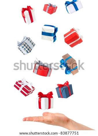 color gift boxes falling on hand - stock photo