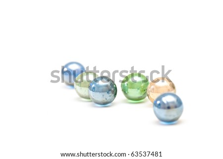 color glass balls lying on a table - stock photo