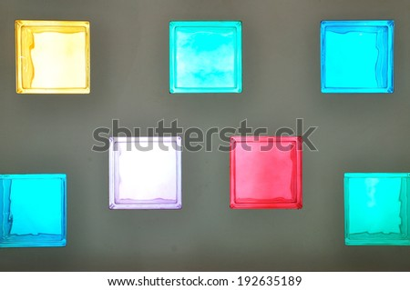 Color Glass Block on grey concrete wall
