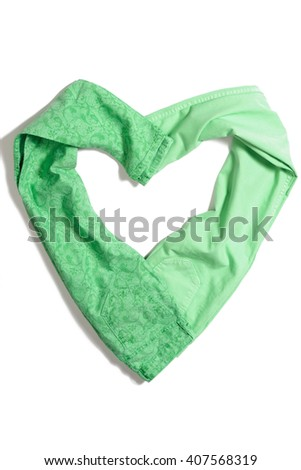 Color green jeans lying isolated on white background heart shaped - stock photo