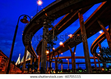 Color guard at night under the bridge across the river - stock photo